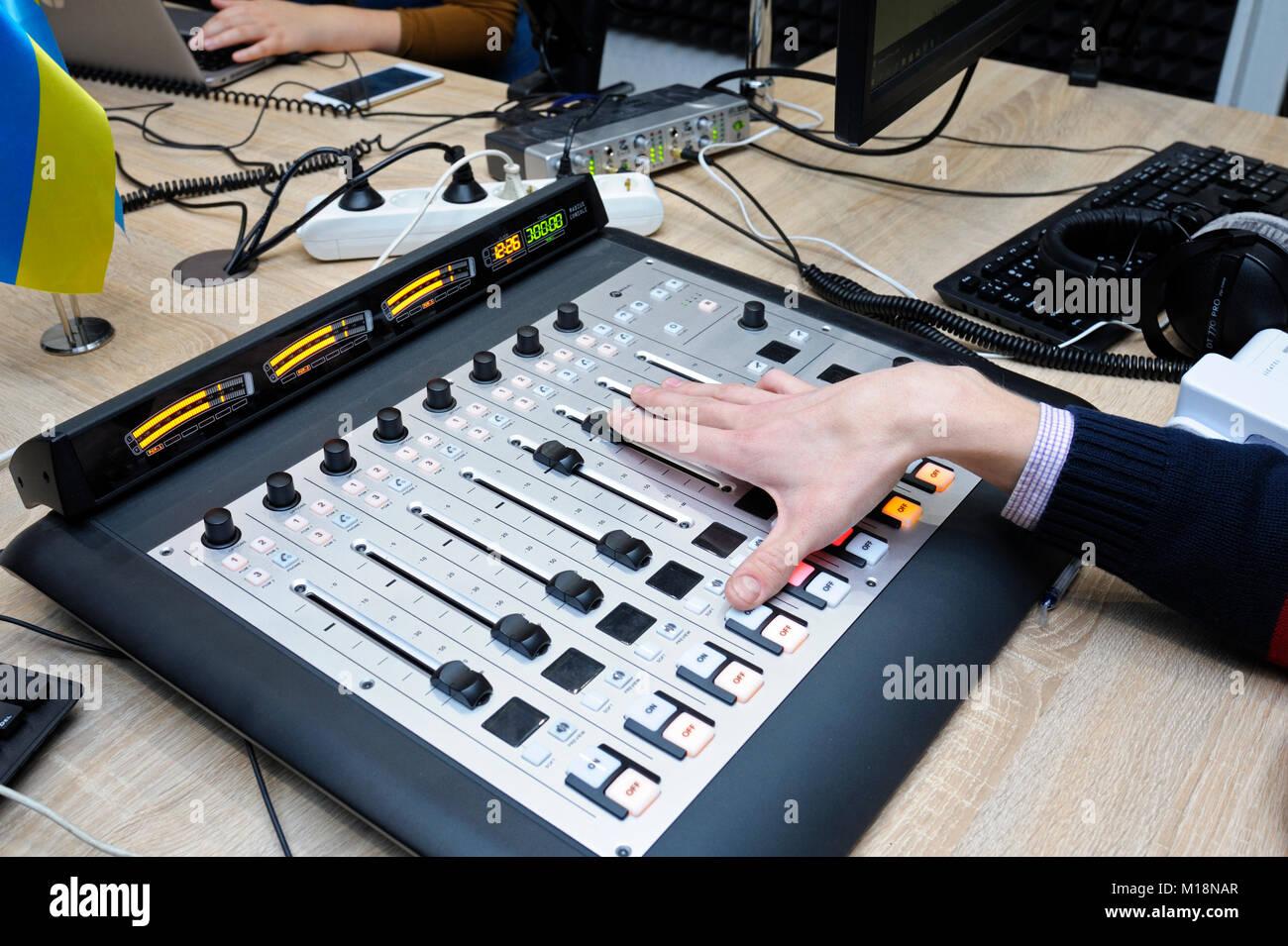 Sound man regulating sound with studio sound mixer at a