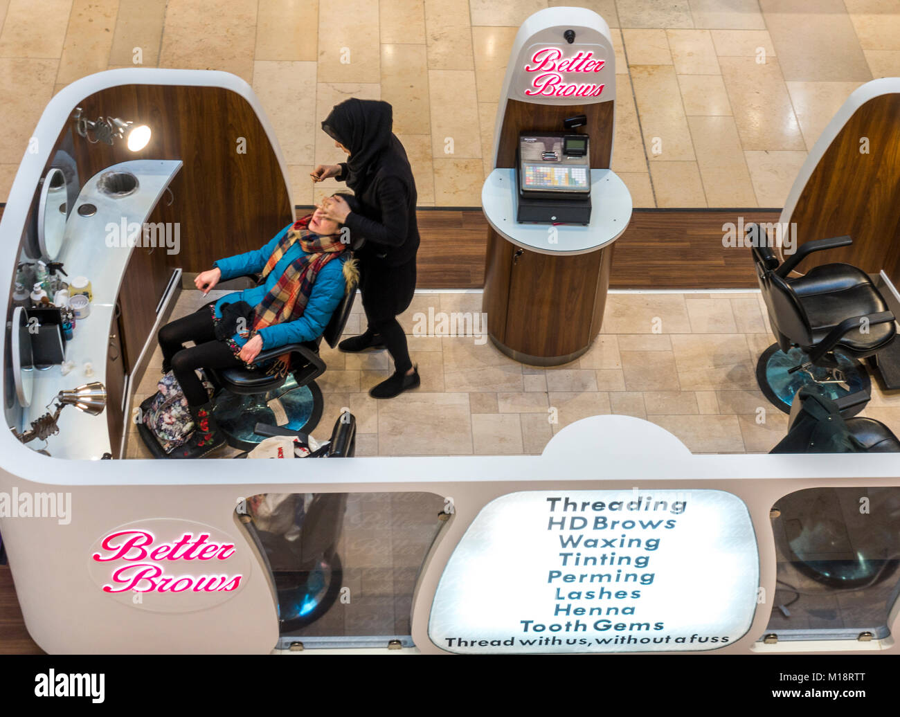 Brow bar: Two women (customer and beautician) in Better Brows walk-in eyebrows bar in the Queensgate shopping centre, - Stock Image