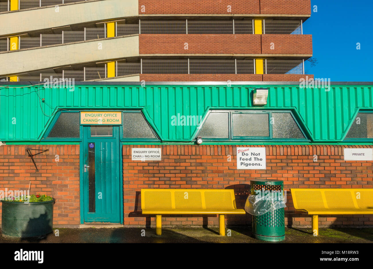 Colourful enquiry office and changing room, with car park behind, next to the market in Peterborough city centre, - Stock Image