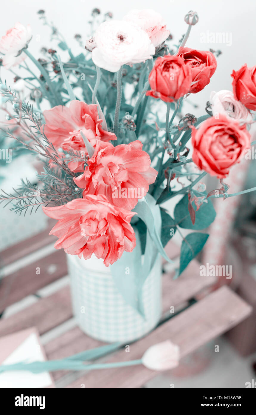 Amazing rose tulips in a vase in a bench Stock Photo