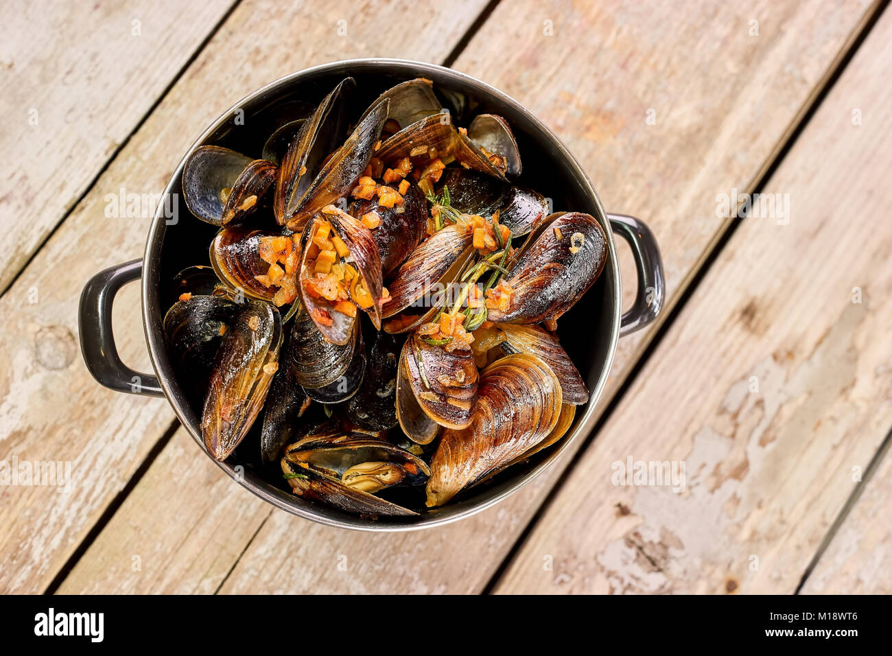 Saucepan of prepared mussels and vegetables. - Stock Image
