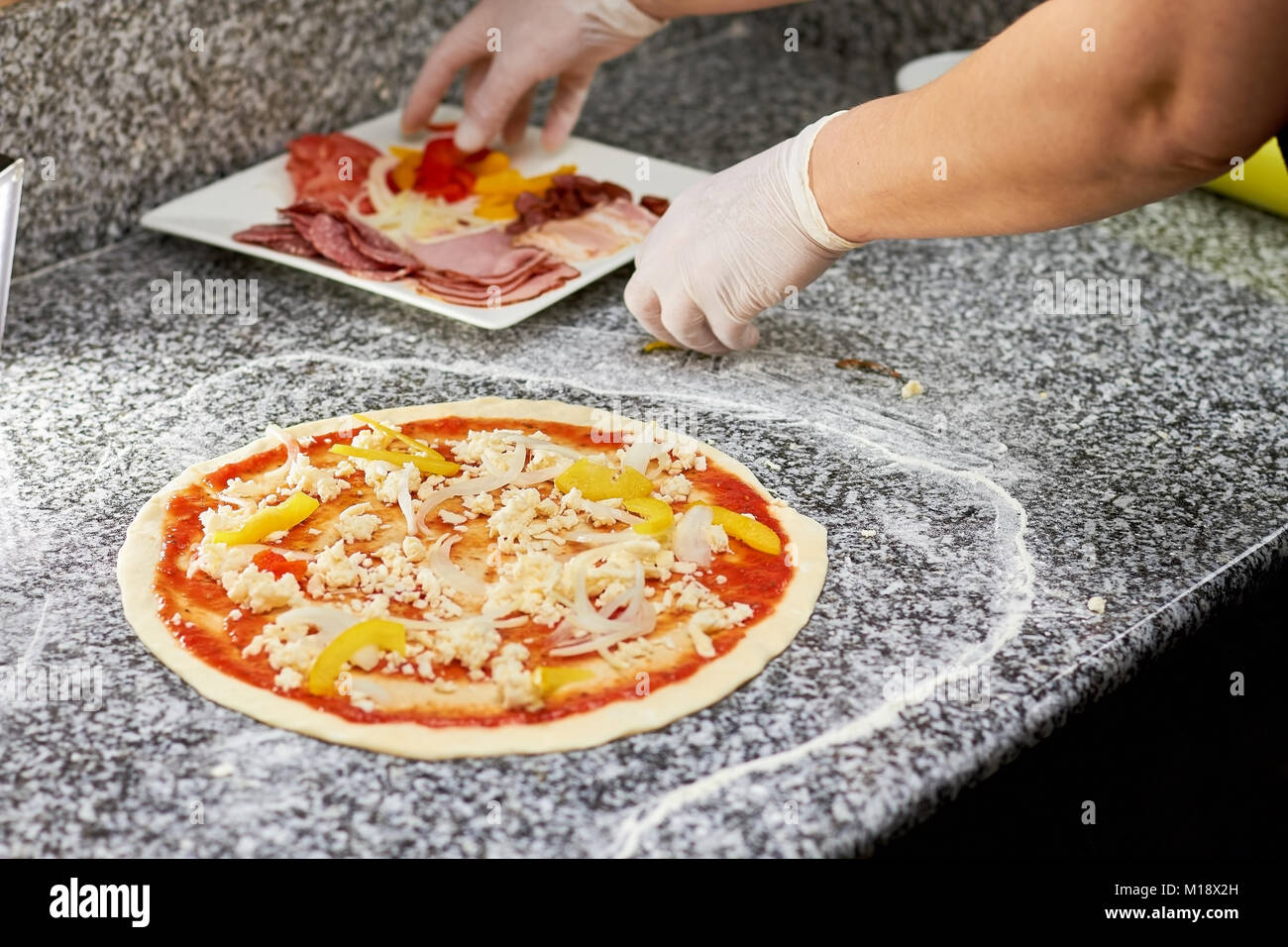 Grabing ingredients of pizza. Stock Photo