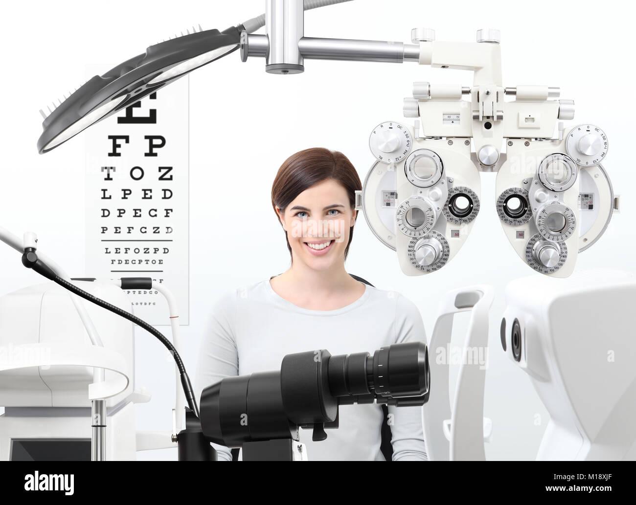 optometrist exam, eyesight  woman patient in optician office - Stock Image