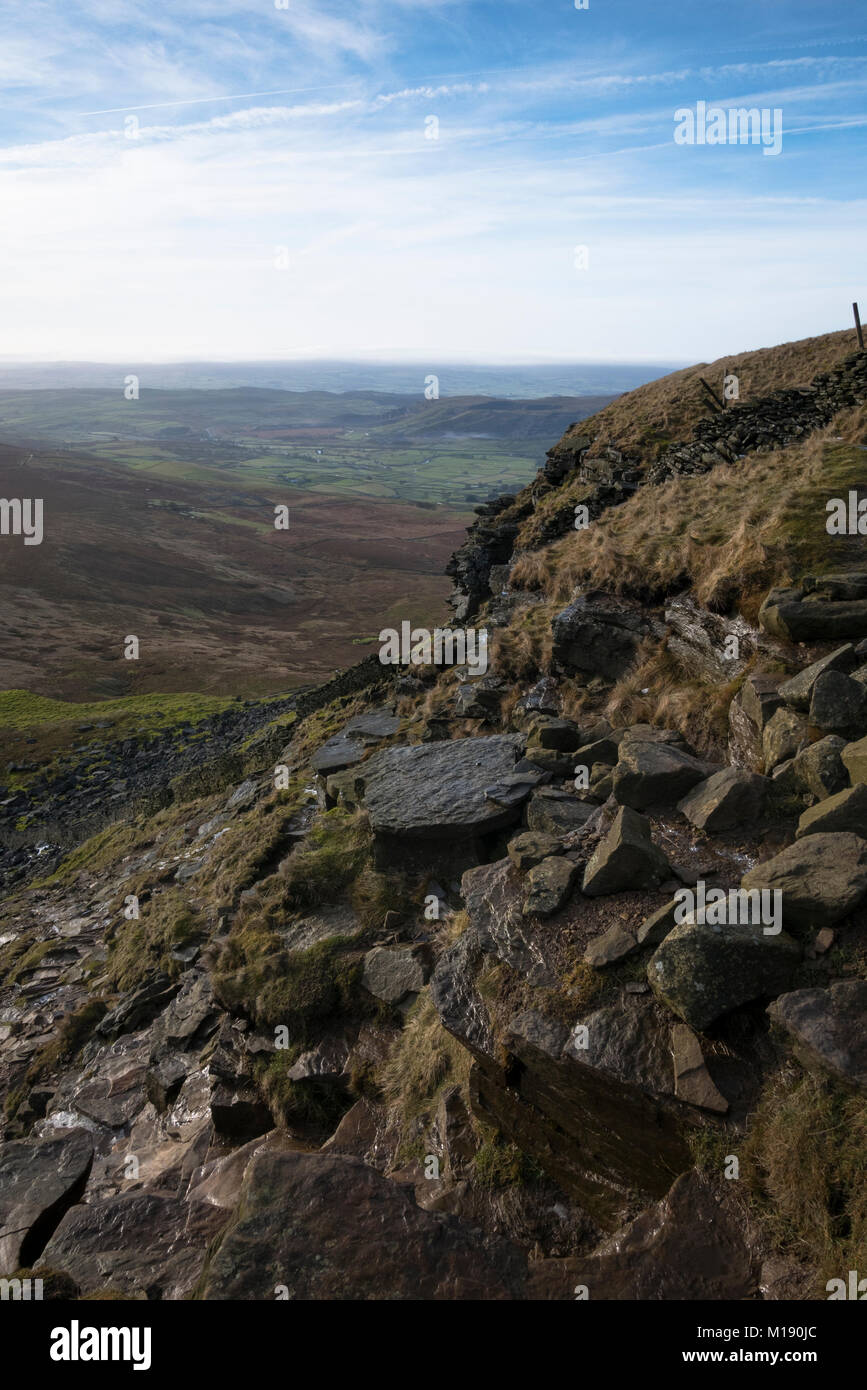 Steep path of the Pennie Way leading up the side of Pen-y-Ghent, one of the three Yorkshire Peaks. - Stock Image