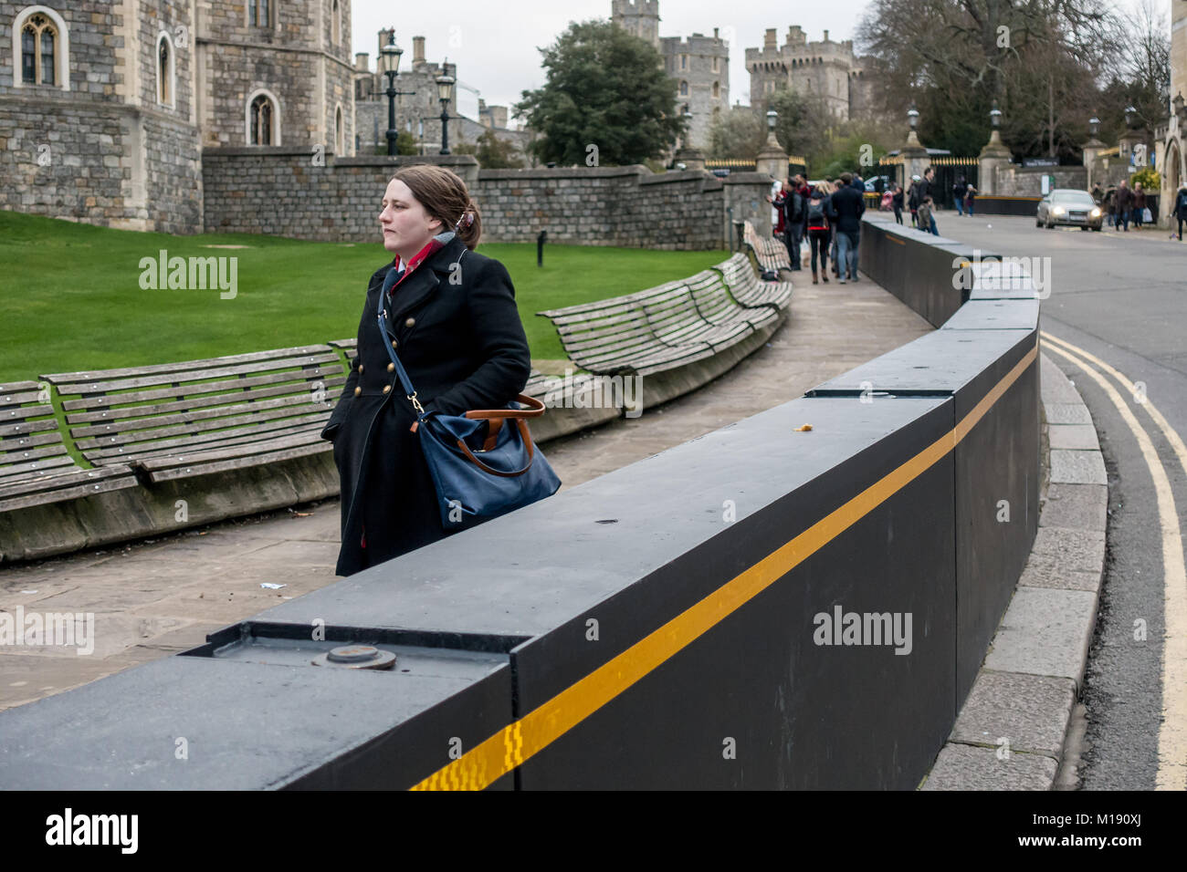 Black barriers to protect pedestrians from terrorism attacks via motor vehicle encircle Windsor Castle in Windsor, - Stock Image