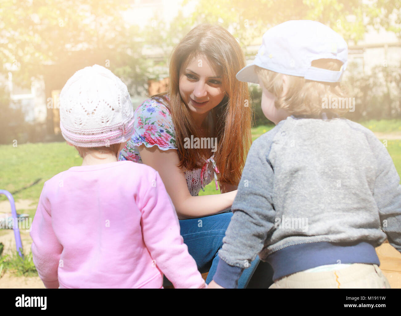 Mom talks to the kids twins and teach them how to act - Stock Image