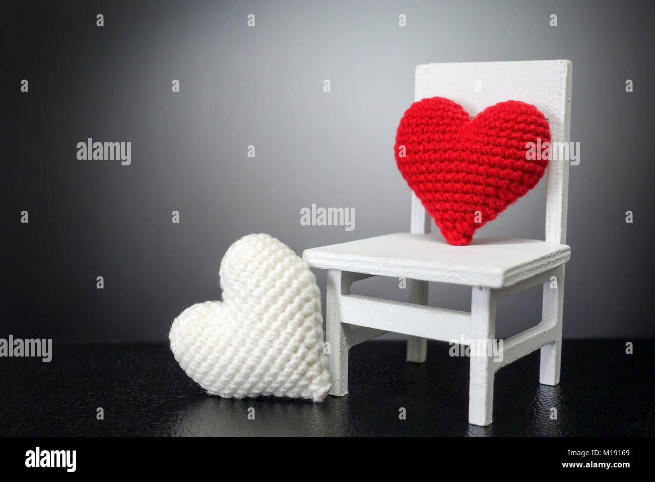 red heart on white chair and white heart with black background love M19169