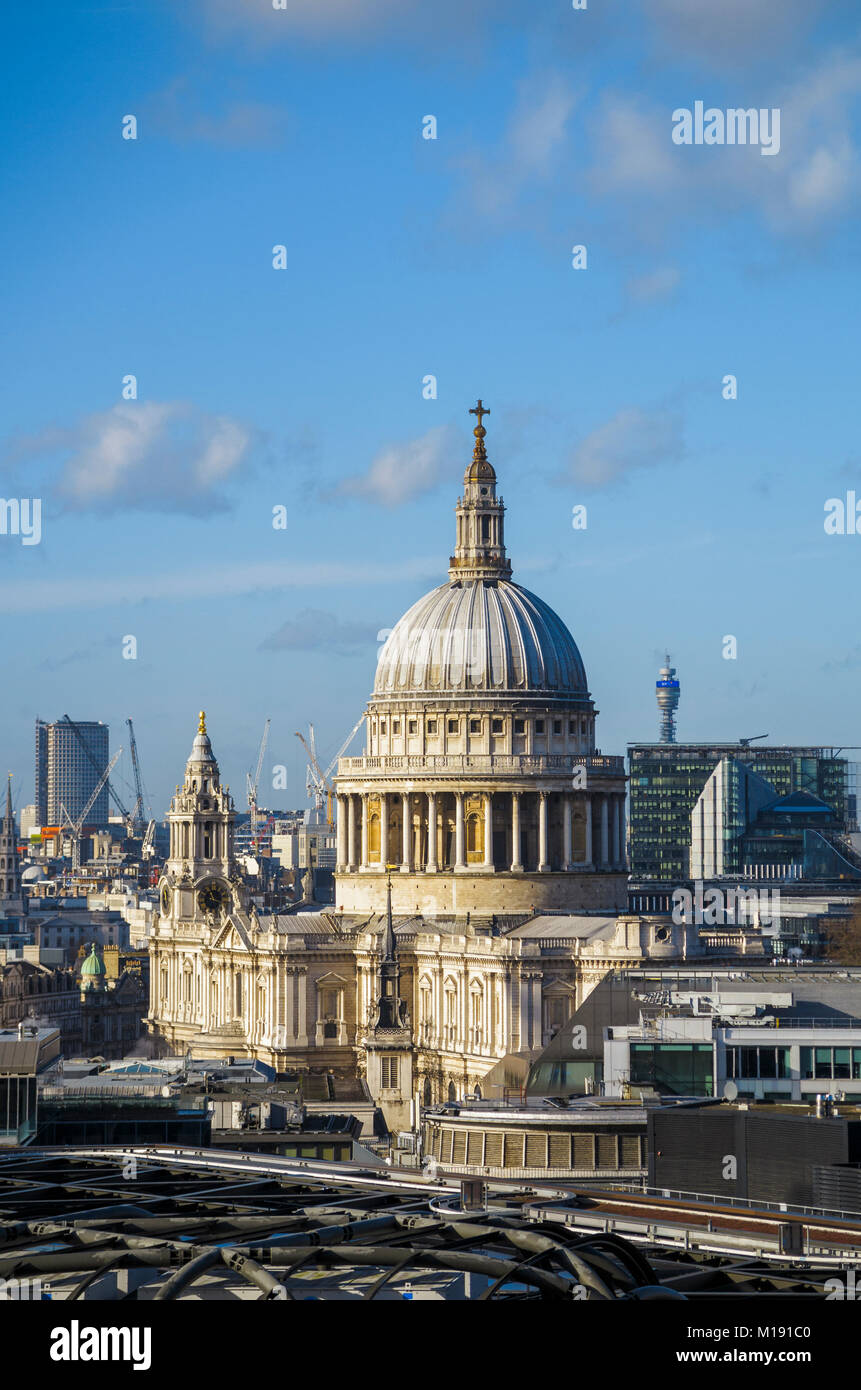 Rooftop view of the iconic dome of St Paul's Cathedral by Sir Christopher Wren on London's skyline, City of London, Stock Photo