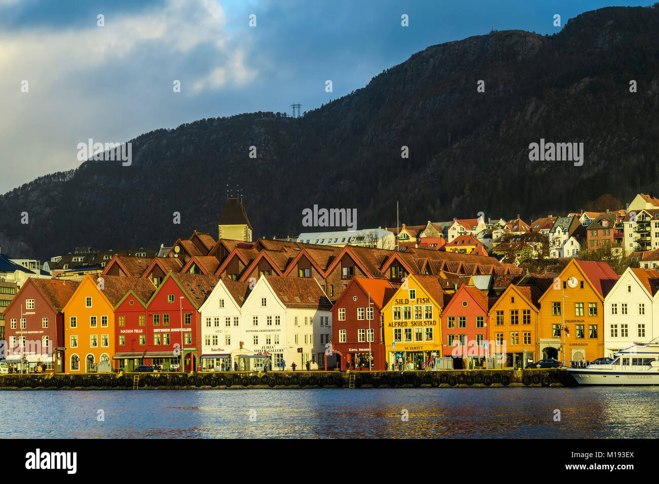 Historic Hanseatic wooden waterfront commercial buildings of the World Heritage listed Bryggen (the dock) on Vagen - Stock Image