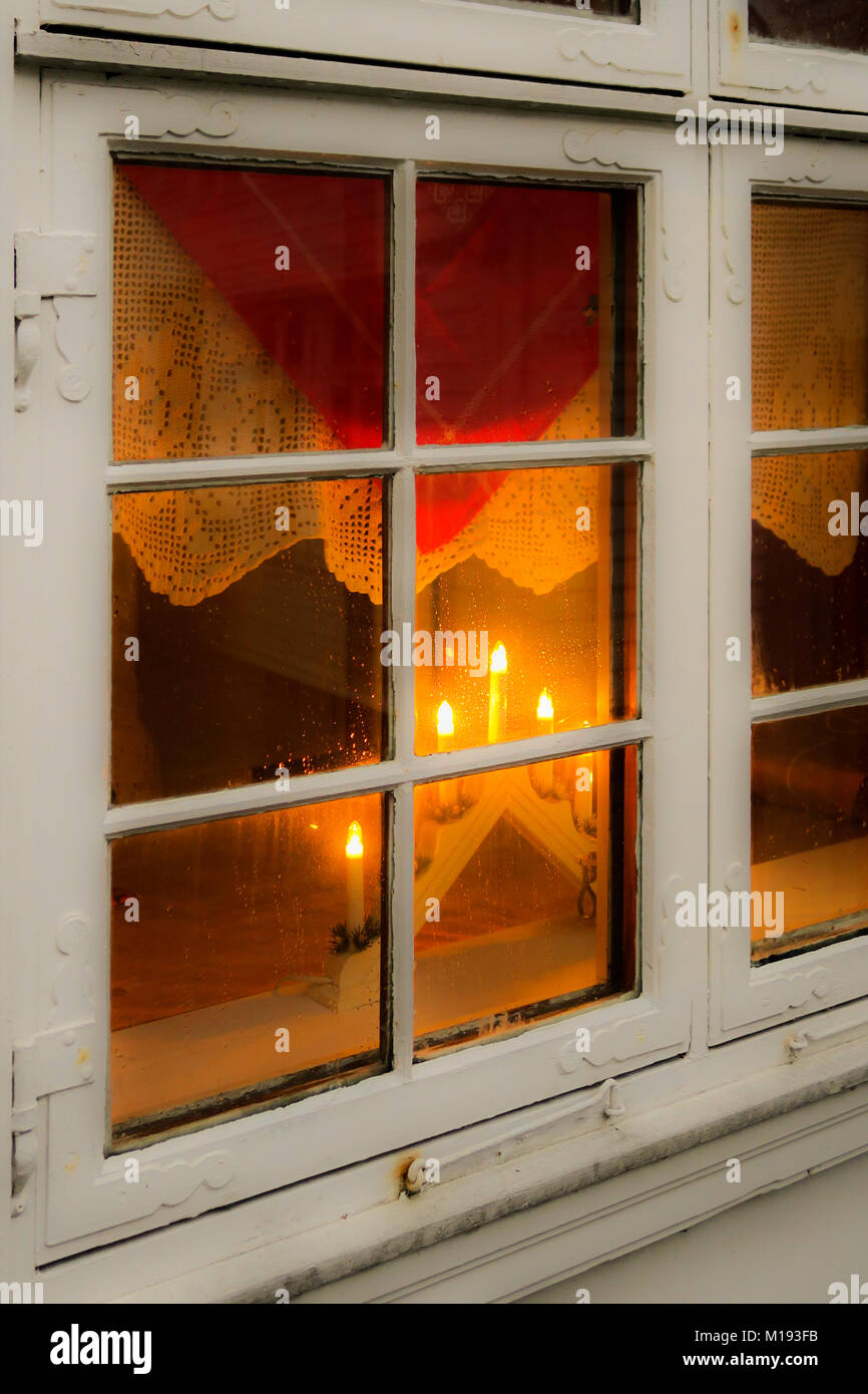 Typical wooden house looking 'hygge' (cosy) with Nordic Christmas electric candles & lace, Tvedtegarden, - Stock Image