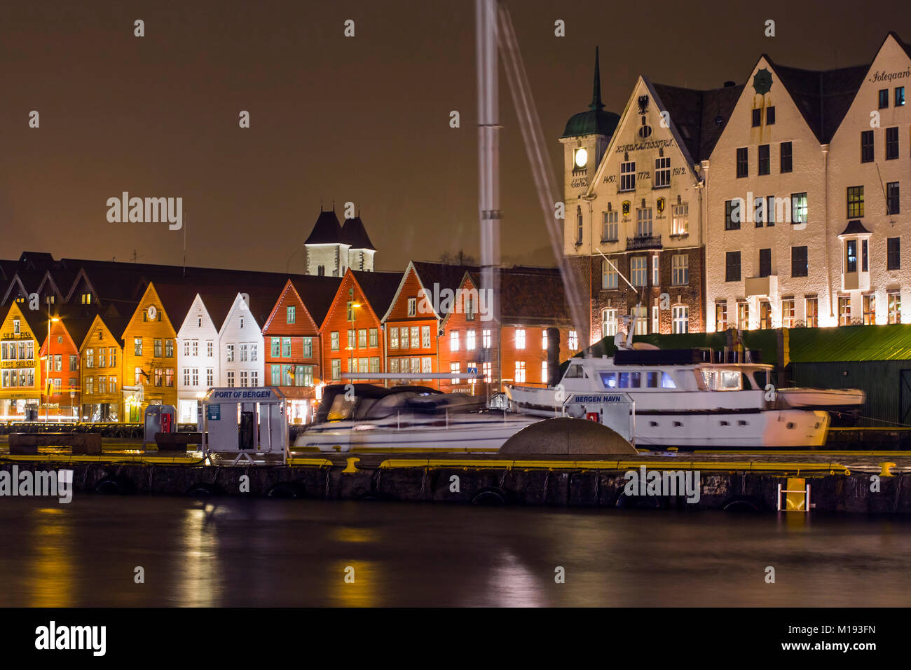 Historic Hanseatic wooden waterfront commercial buildings of World Heritage listed Bryggen (the dock) at night. - Stock Image