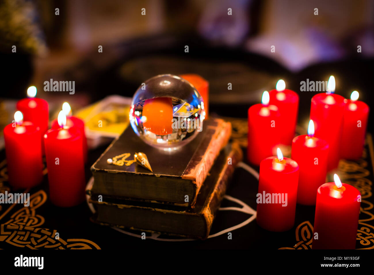 Crystal ball in the candle light to prophesy - Stock Image