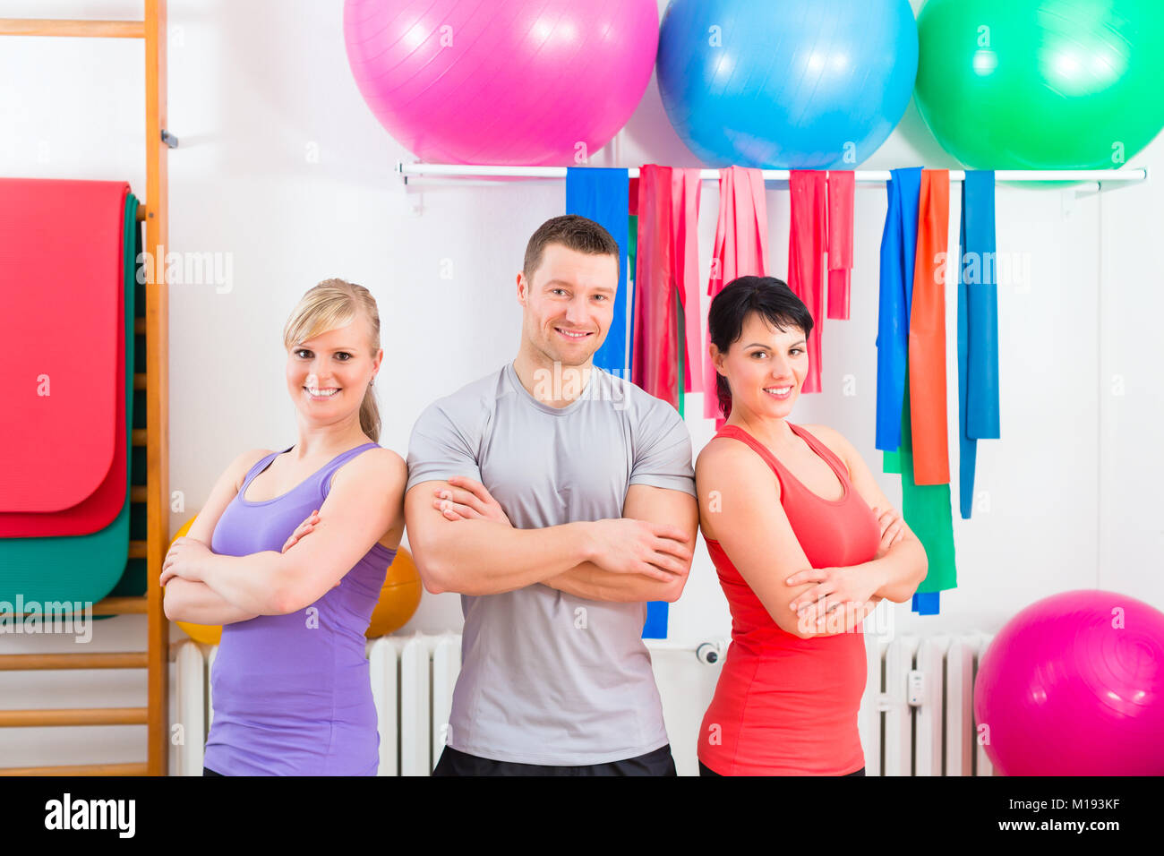 Patients after physical exercises with trainer - Stock Image