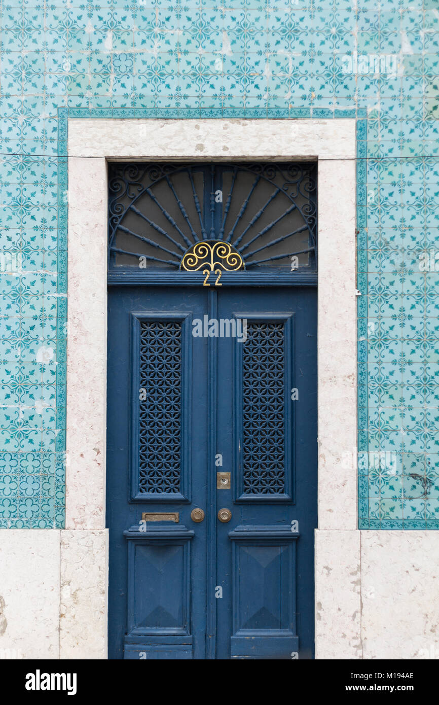 antique blue front door in town - Stock Image - Antique Front Doors Stock Photos & Antique Front Doors Stock Images
