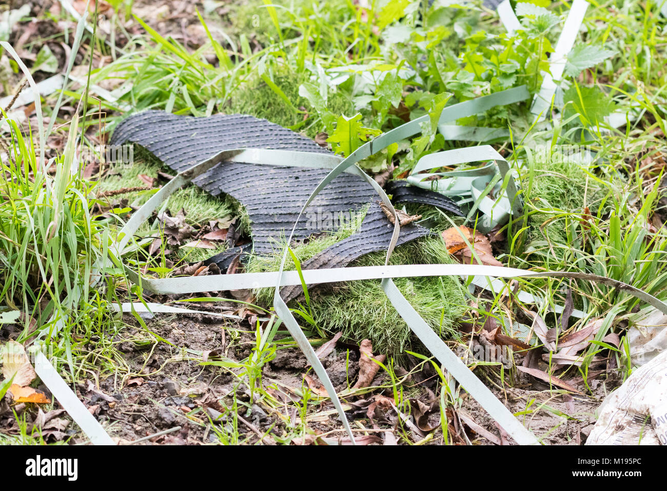 artificial grass and other plastic dumped in the countryside - England, UK - Stock Image