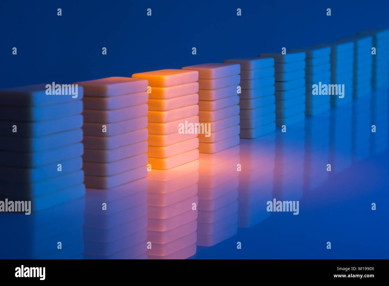 Dominoes on reflective surface. Metaphor for concept of data storage, server farm, or server farm abstract. Data - Stock Image