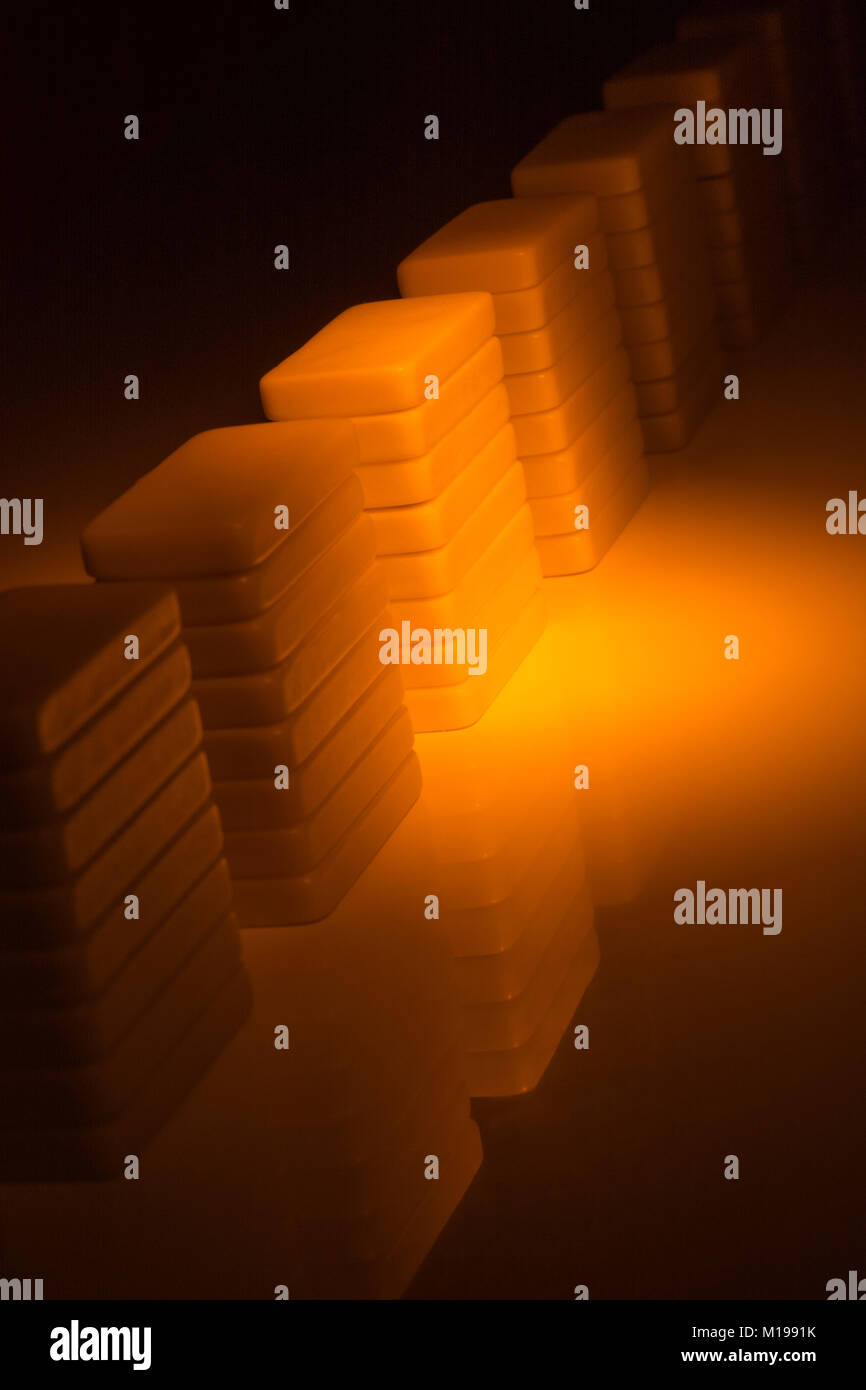 Dominoes on reflective surface. Metaphor for concept of data storage, server farm, or server farm abstract. - Stock Image