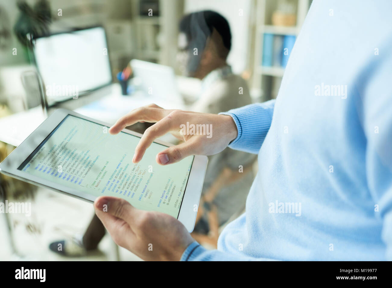 Web Developer Checking Code - Stock Image