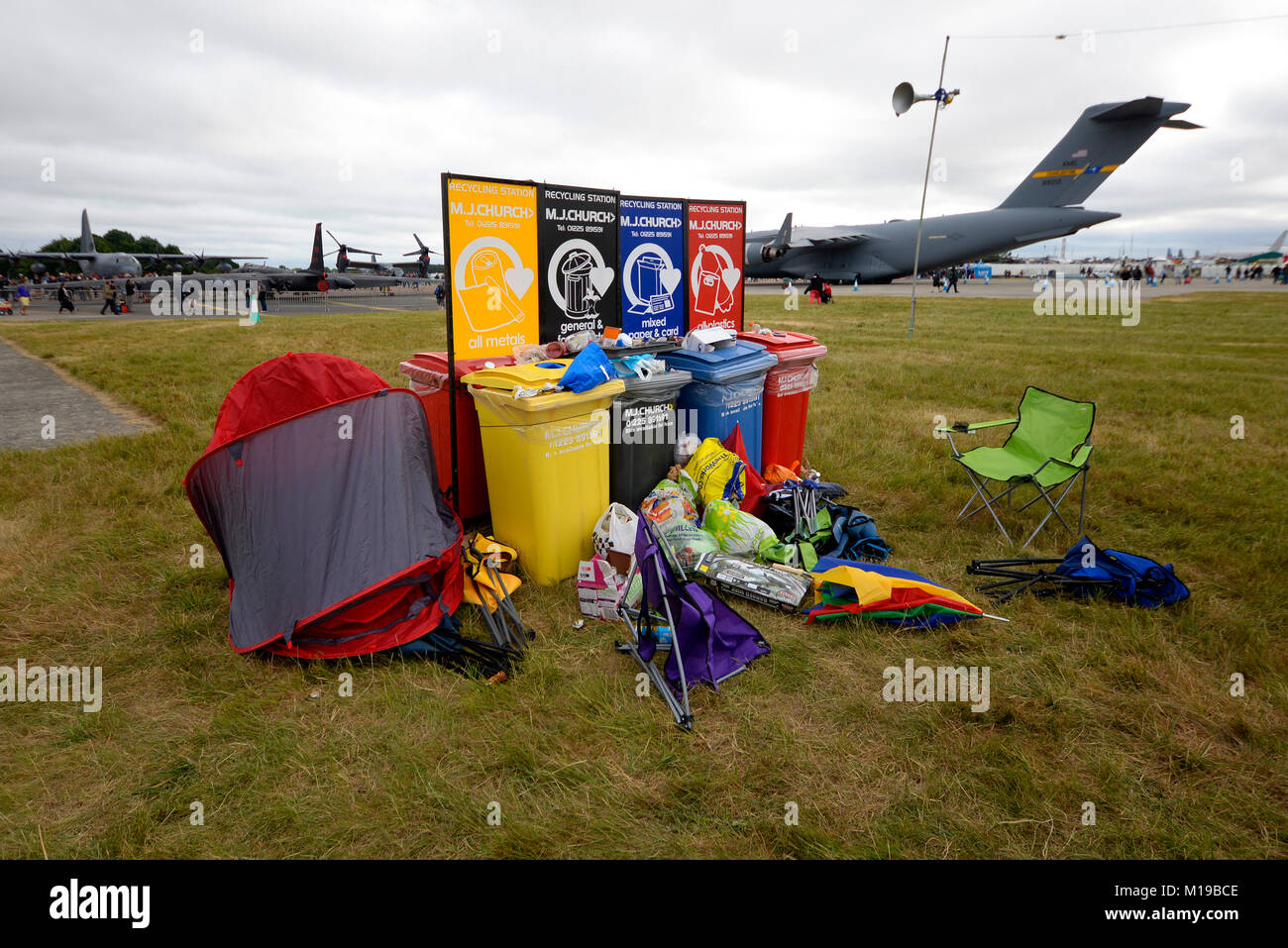 Broken chairs, umbrellas and tent discarded by the rubbish and recycling bins after the Royal International Air - Stock Image