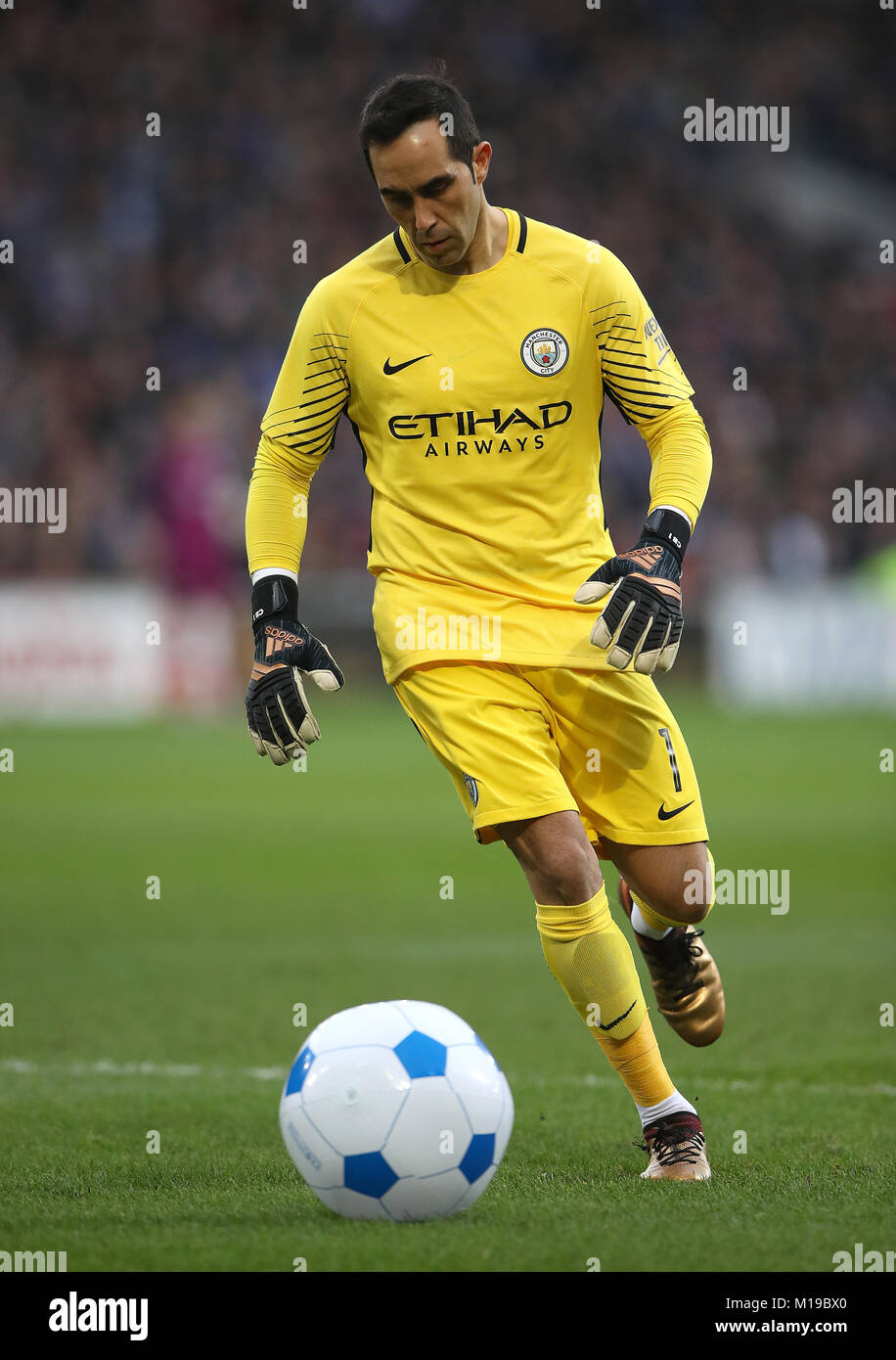 0b8fb50fe6d Manchester City goalkeeper Claudio Bravo deals with an inflatable football  during the Emirates FA Cup