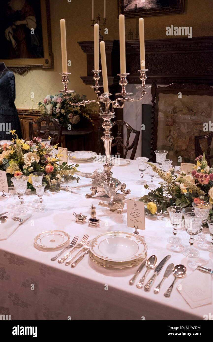 An upstairs set table for the aristocrats at Downton Abbey The Exhibition on West 57th Street in Midtown Manhattan, - Stock Image
