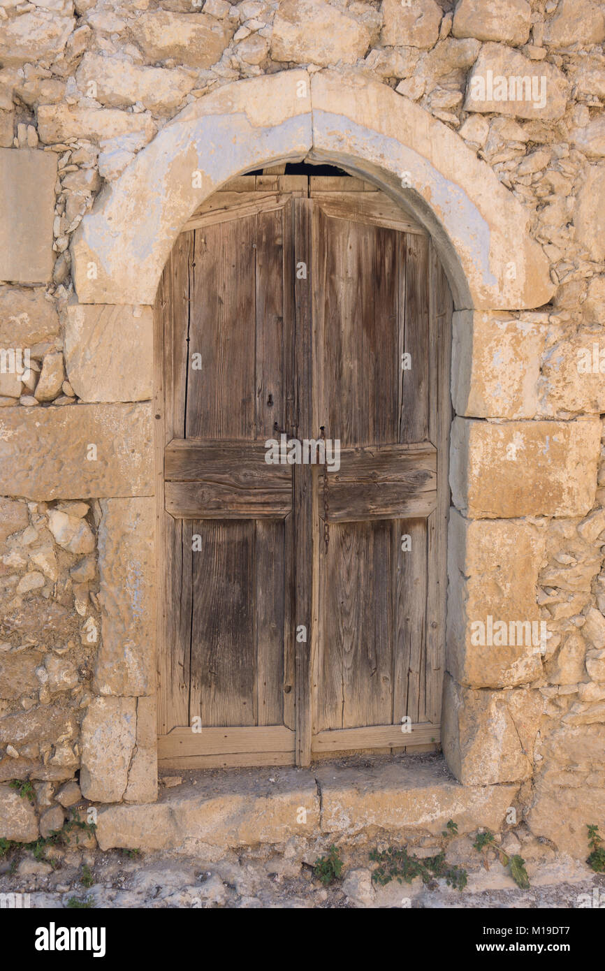 Old wooden doorway, Margaritas village, Rethimno Region, Crete (Kriti), Greece - Stock Image