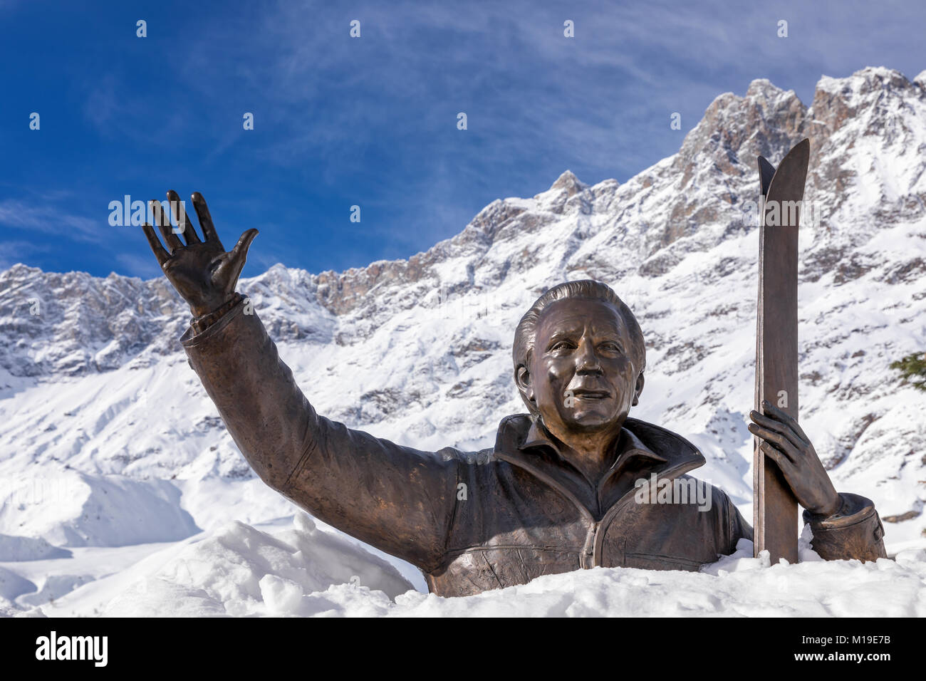 Statue of Mike Bongiorno covered in snow, Breuil-Cervinia, Aosta Valley, Italy - Stock Image