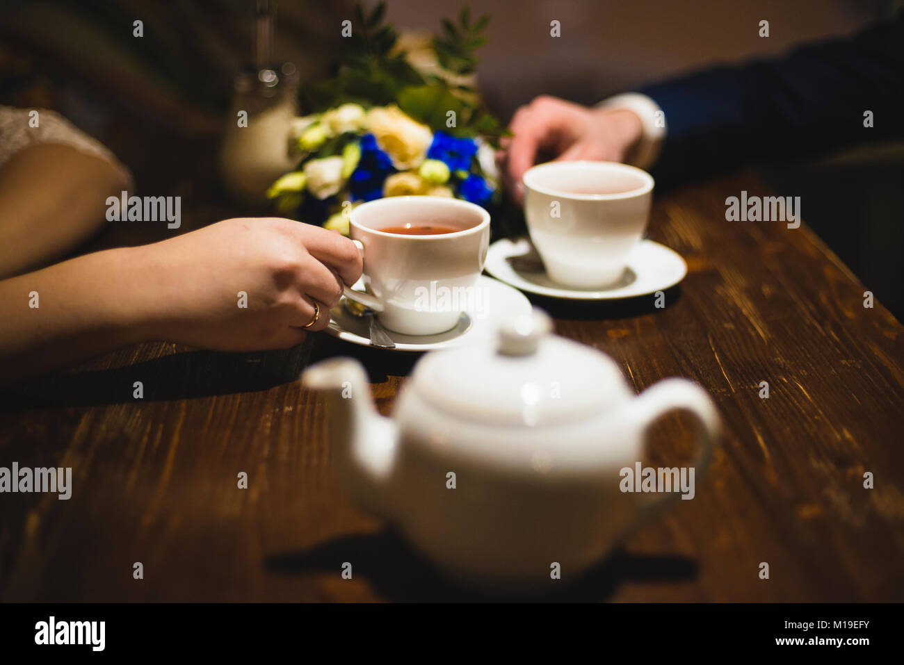 white cups in the hands with a shallow depth of field - Stock Image