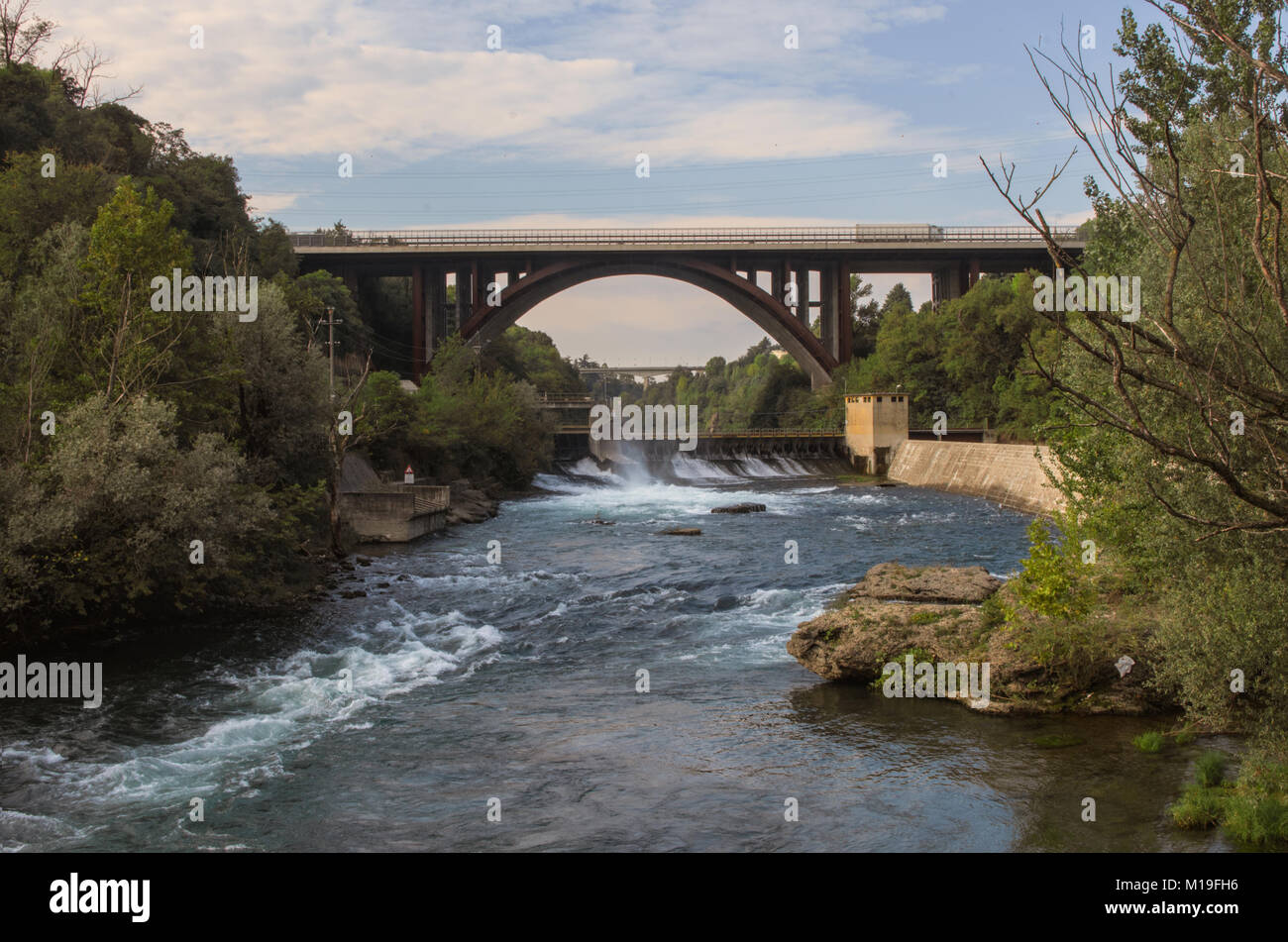 view of dam for hydroelectric power production and highway bridge on the Adda river Stock Photo