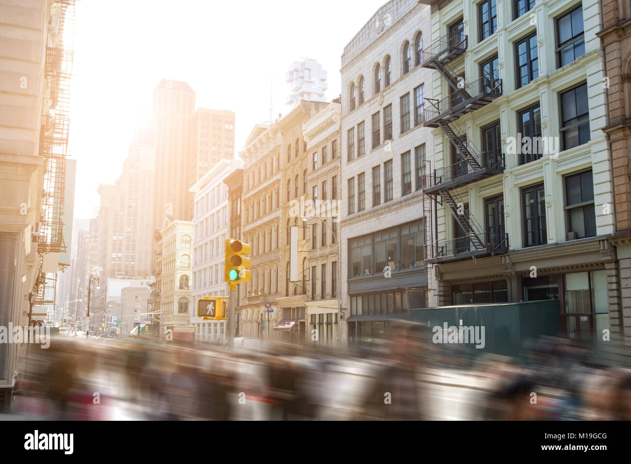 Fast paced motion blur of people walking down Broadway in SoHo Manhattan, New York City - Stock Image