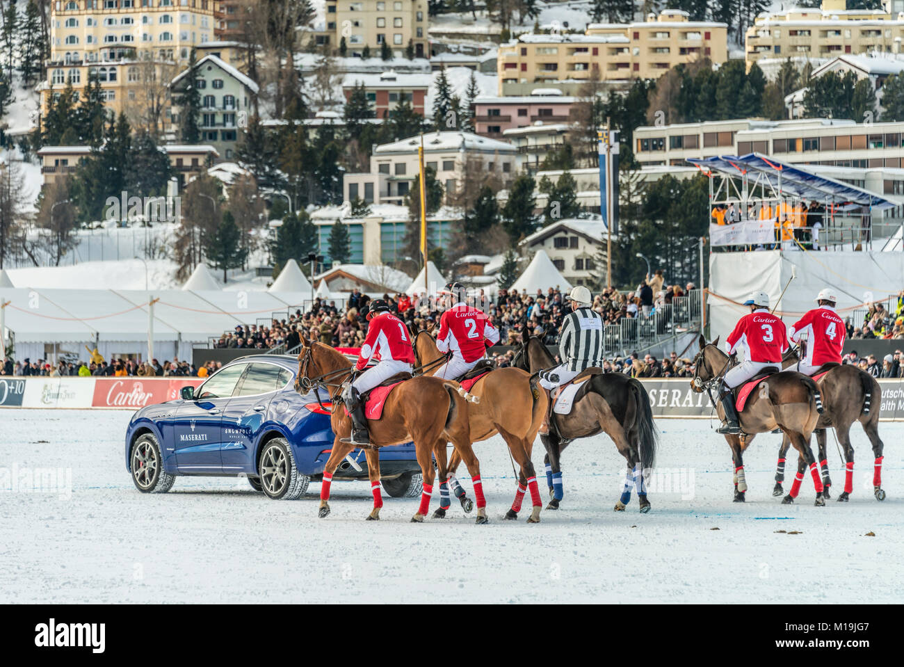 St.Moritz, Switzerland. 28th Jan, 2018. Members of the 'Cartier' team behind a Maserati Sponsor car during - Stock Image