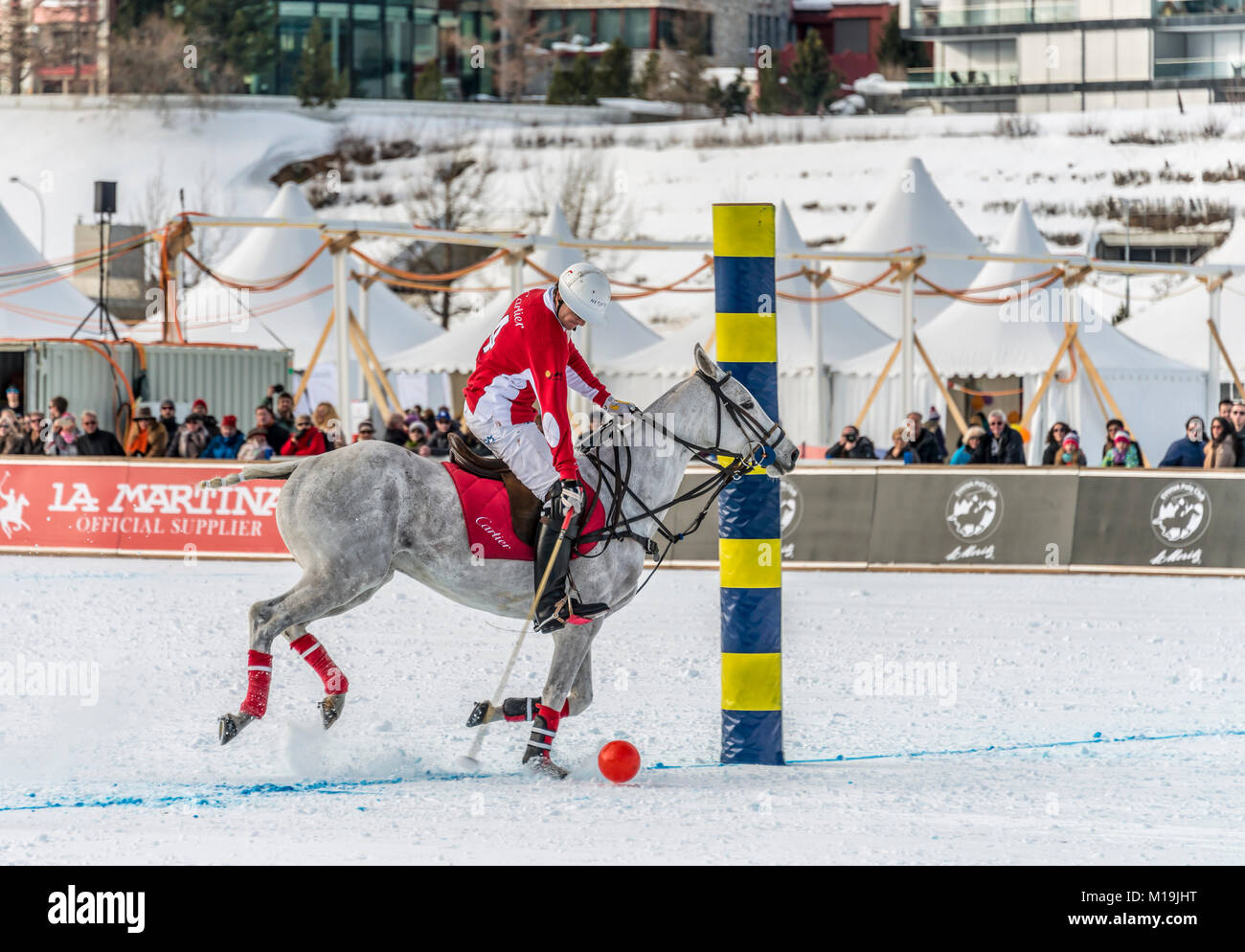 St.Moritz, Switzerland. 28th Jan, 2018. Member of the 'Cartier' team scoring a goal during the final of - Stock Image