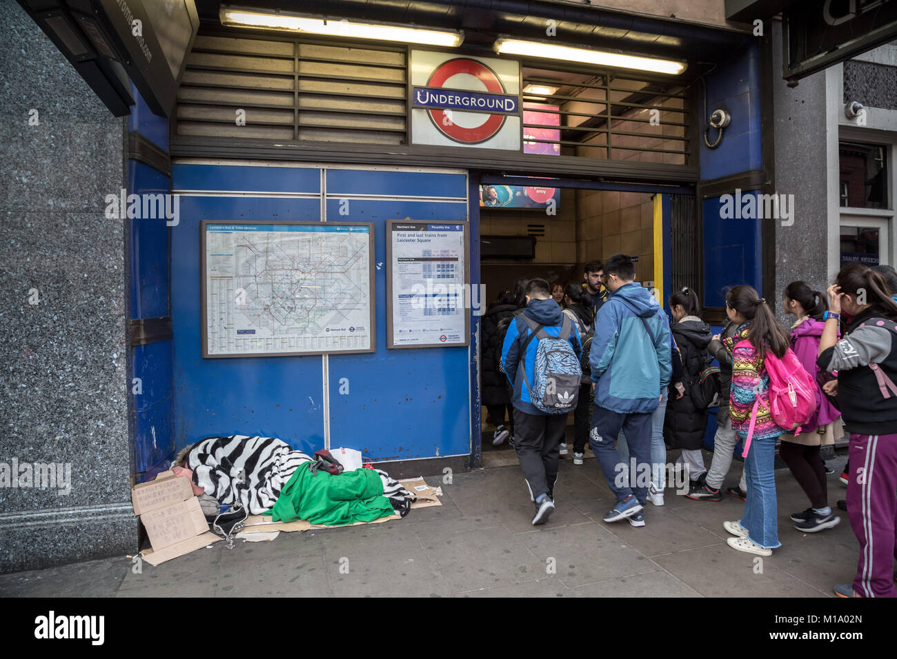 London, UK. 28th Jan, 2018. A rough sleeper during the day outside Leicester Square underground station. Credit: - Stock Image