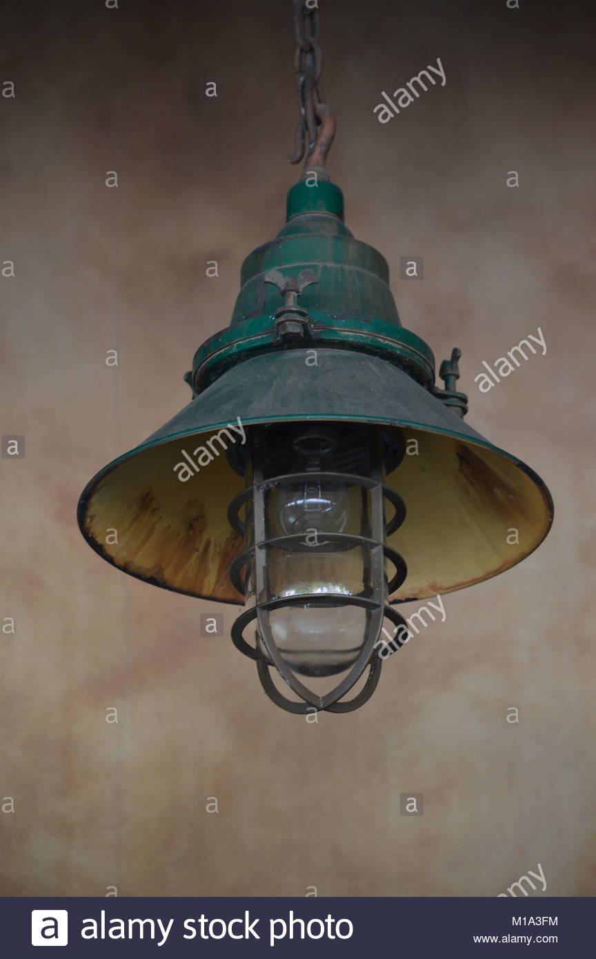 Old Fashioned Western Themed Railway Hanging Wall Light Stock Image