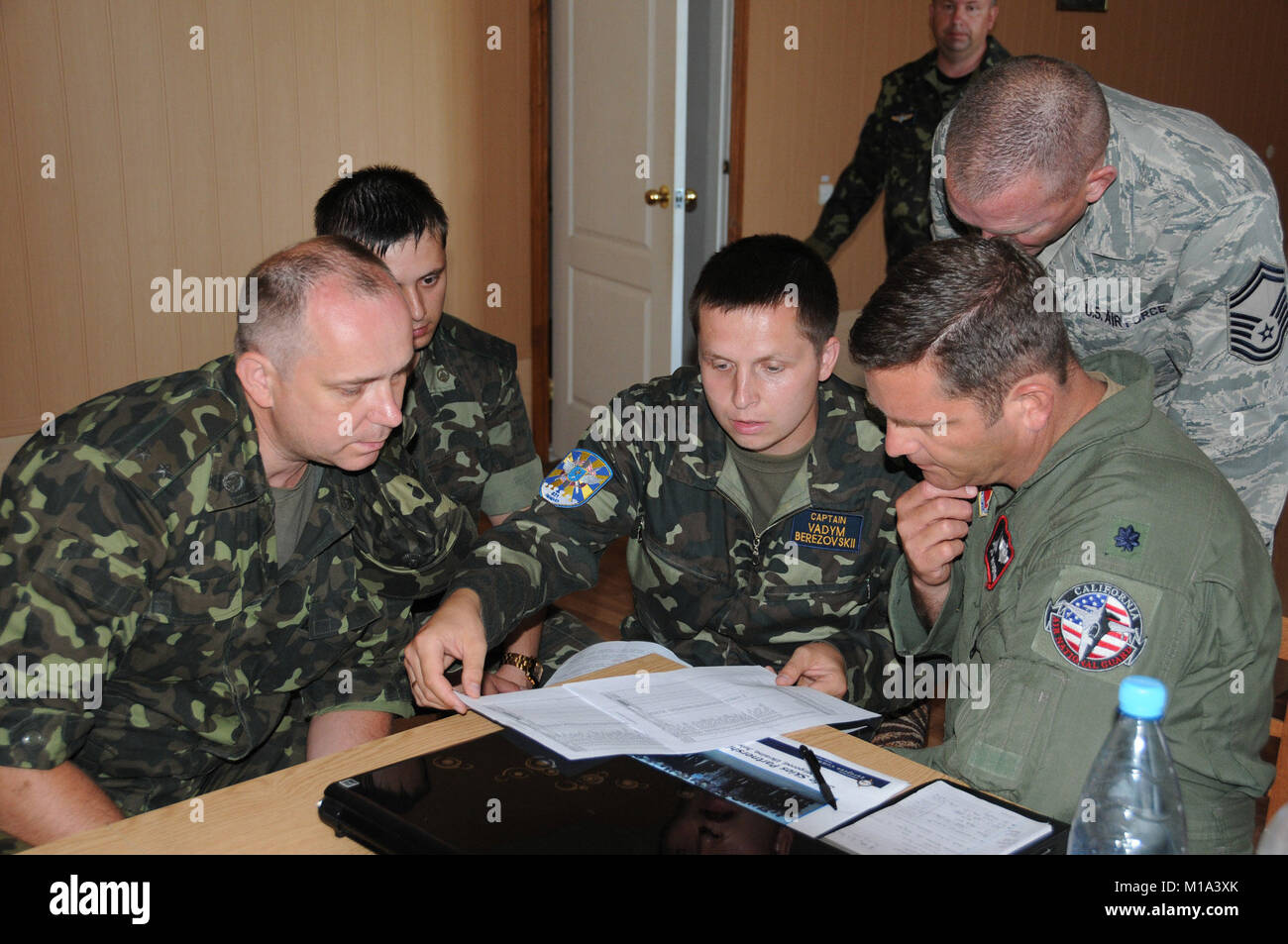 110716-Z-VM449-005 Lt. Col. Robert Swertfager, 144th Fighter Wing California Air National Guard, discusses the itinerary - Stock Image
