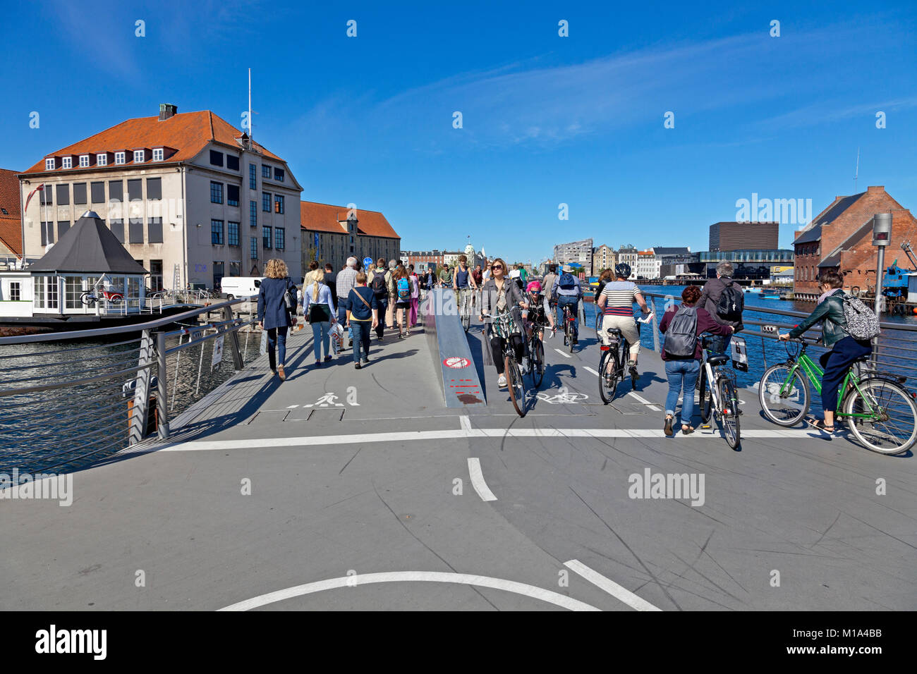 View from Christianshavn at the Trangrav Bridge, a cyclist and pedestrian bridge connected to the inner harbour - Stock Image
