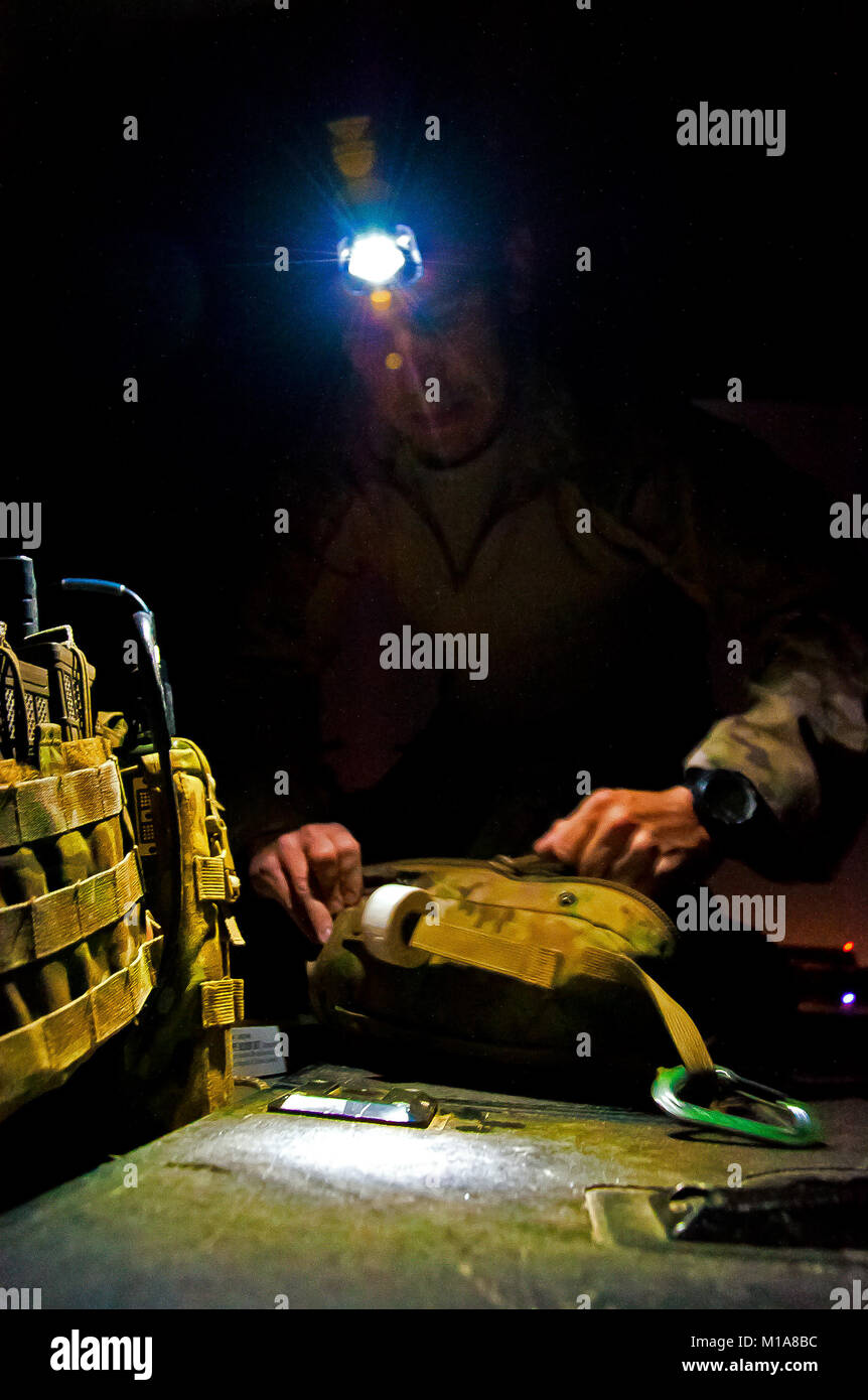 U.S. Air Force Staff Sgt. Nicholas Plummer, 26th Expeditionary Rescue Squadron pararescueman, inspects medical equipment - Stock Image