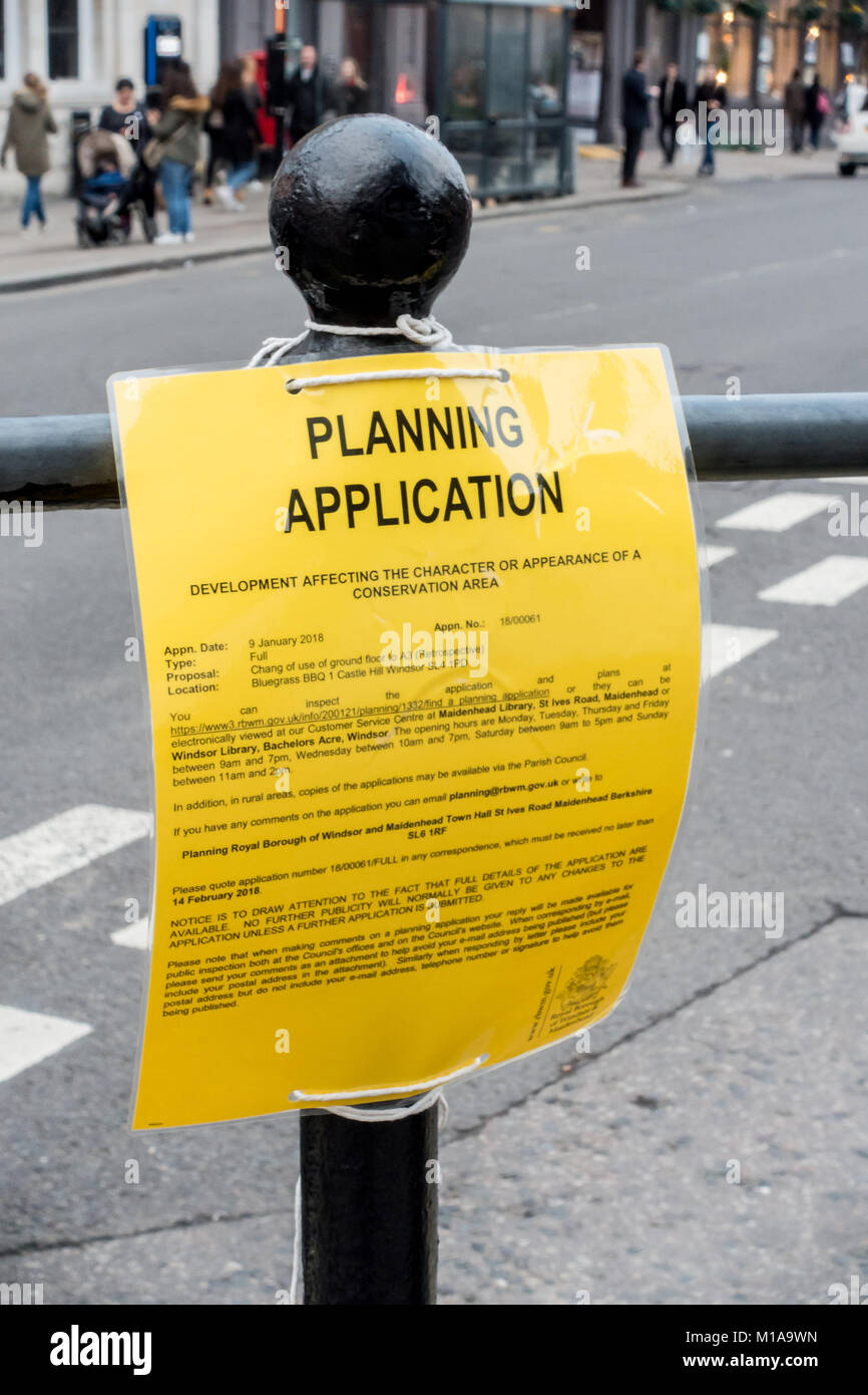 A planning application notice attached to a bollard in Windsor contains a spelling error. - Stock Image