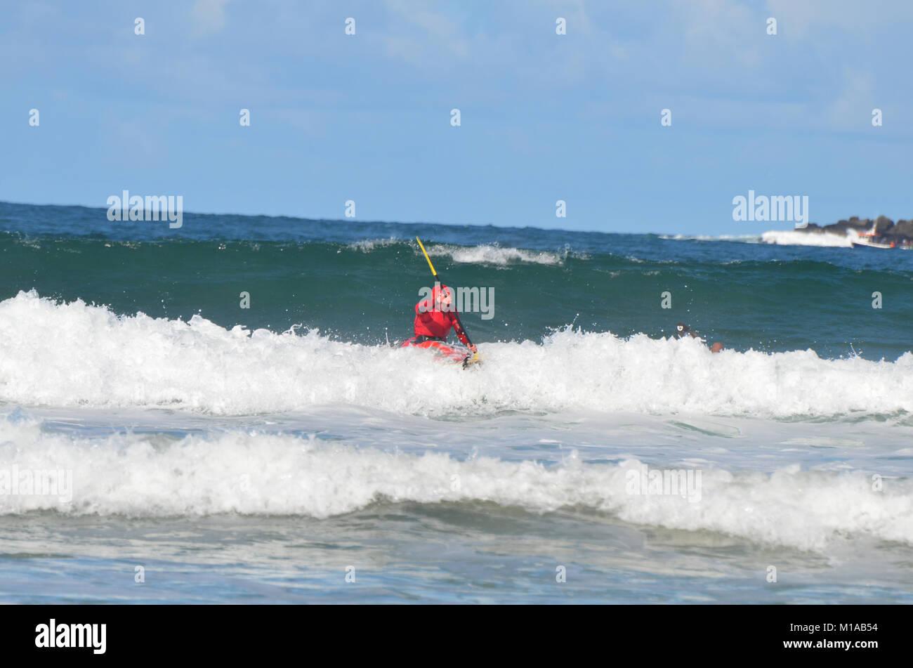 Portrush, Co.Antrim, Northern Ireland. September 14th 2013 :-A Kyaker rides the atlantic surf - Stock Image