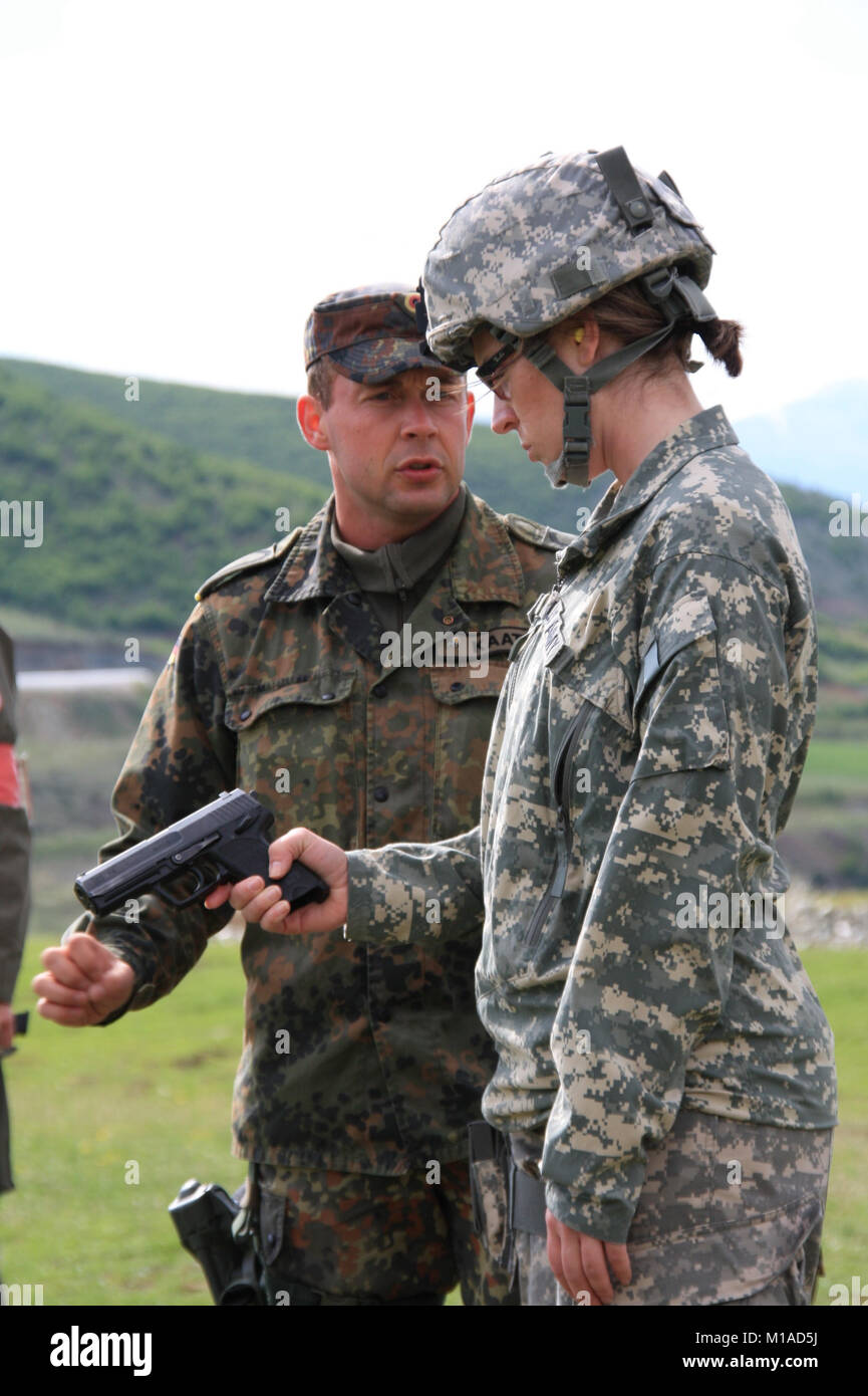 090430-A-4563S-003  A German soldier instructs a Soldier from the California National Guard on how to shoot their - Stock Image