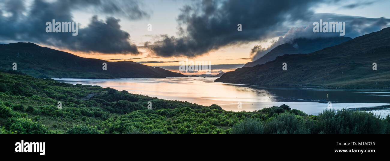 Looking west at dusk along the fjord of Killary Harbour on a still summer evening after sunset from Leenane, Connemara, - Stock Image