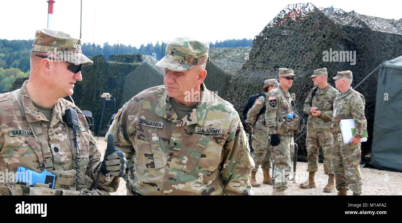Brig. Gen. Mark Malanka, deputy commander for the California Army National Guard's 40th Infantry Division, confers - Stock Image