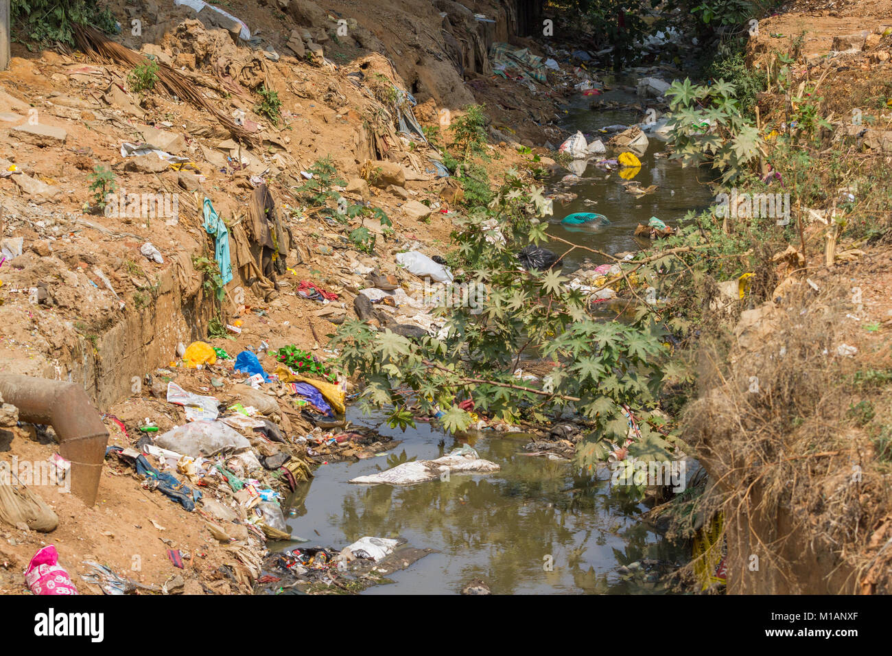 Plastic garbage floating in river. India, Nilgiri, Coonoor town. - Stock Image