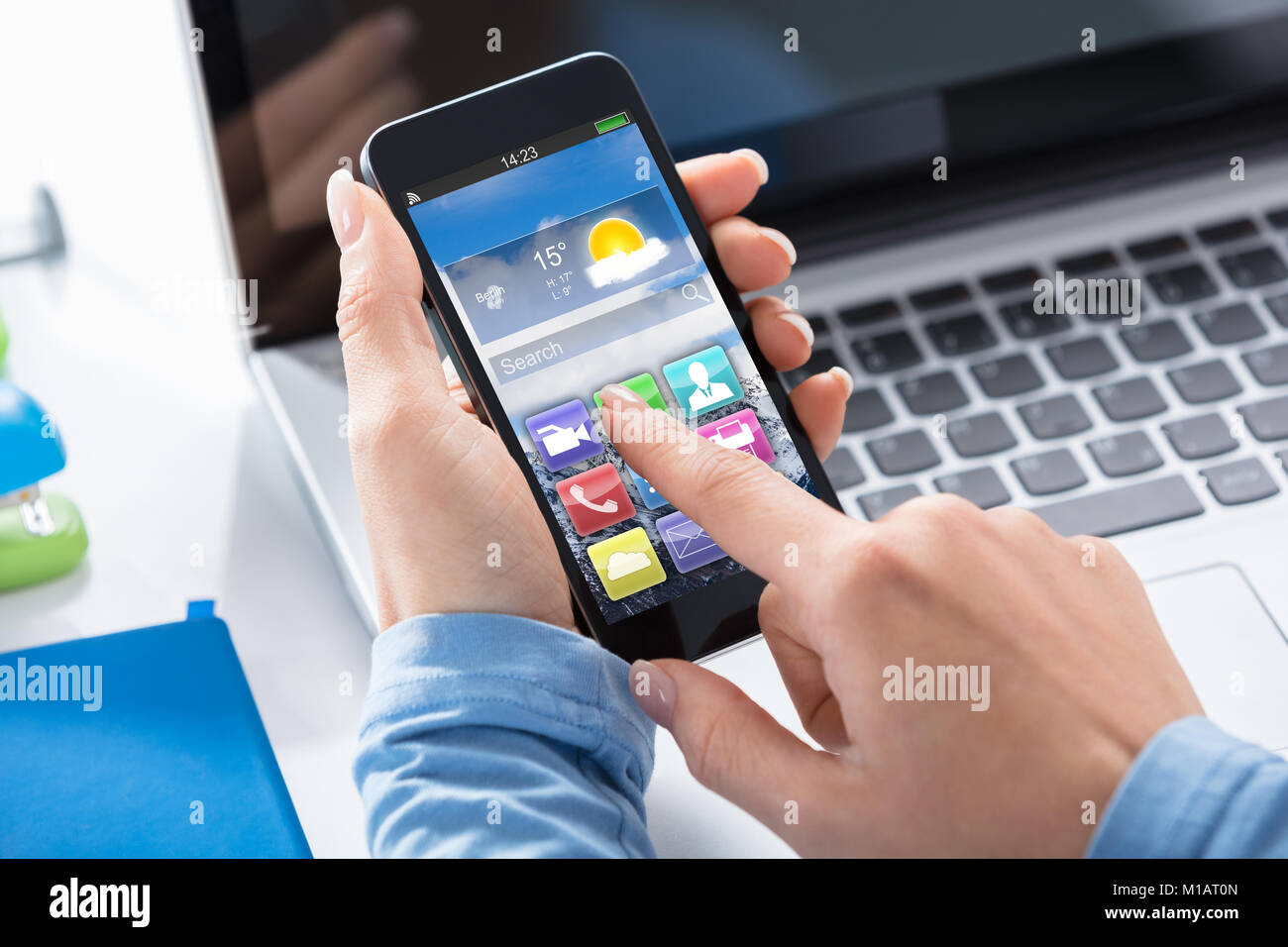 Close-up Of A Woman Using Touchscreen Smart Phone With Applications On Screen - Stock Image