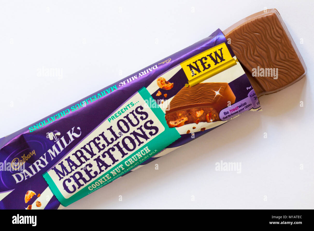 Cadbury Dairy Milk presents Marvellous Creations - cookie nut crunch opened to show contents set on white background - Stock Image