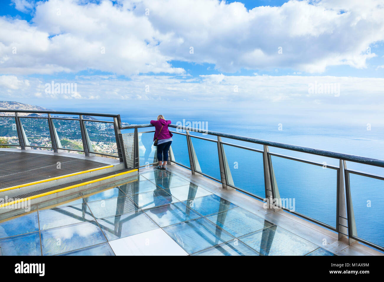Cabo girao madeira portugal madeira Tourist on glass viewing platform at Cabo Girao skywalk a high sea cliff south - Stock Image