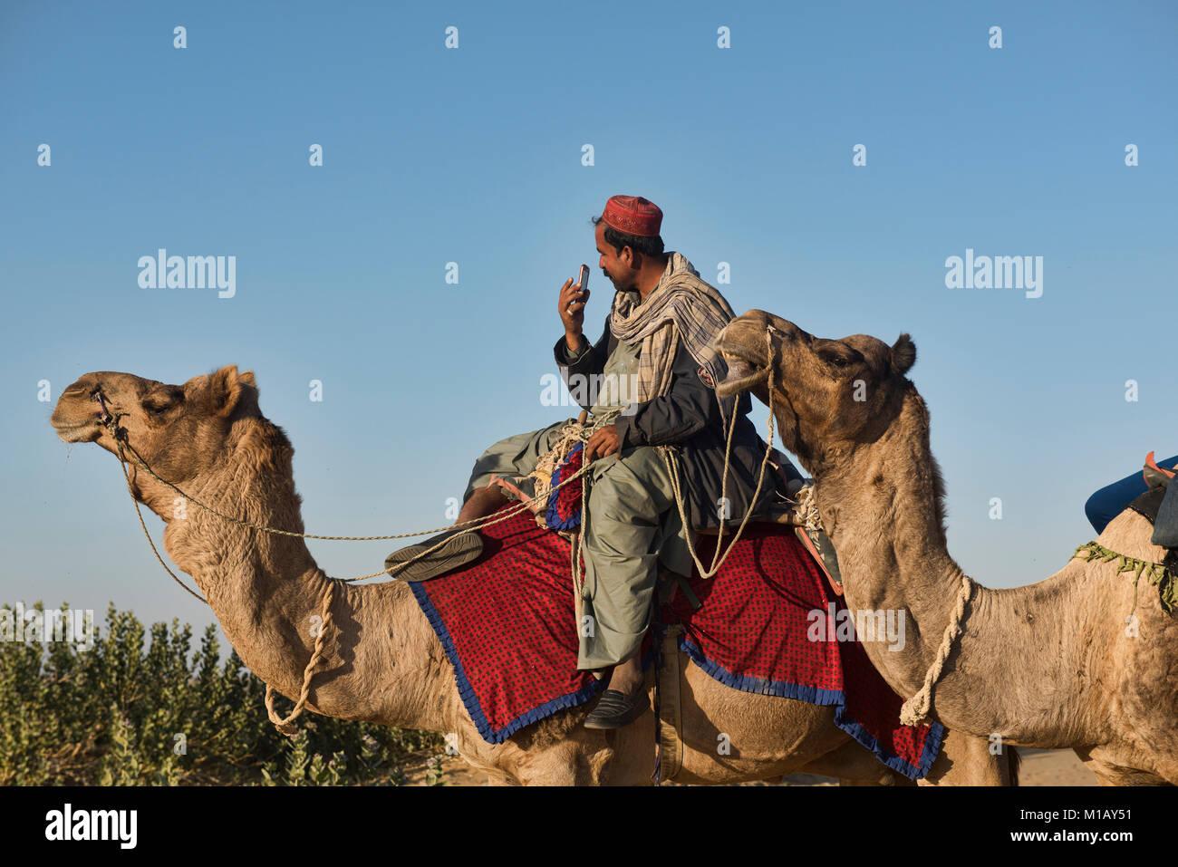 Modern day camel trekking in the Thar Desert, Rajasthan, India - Stock Image