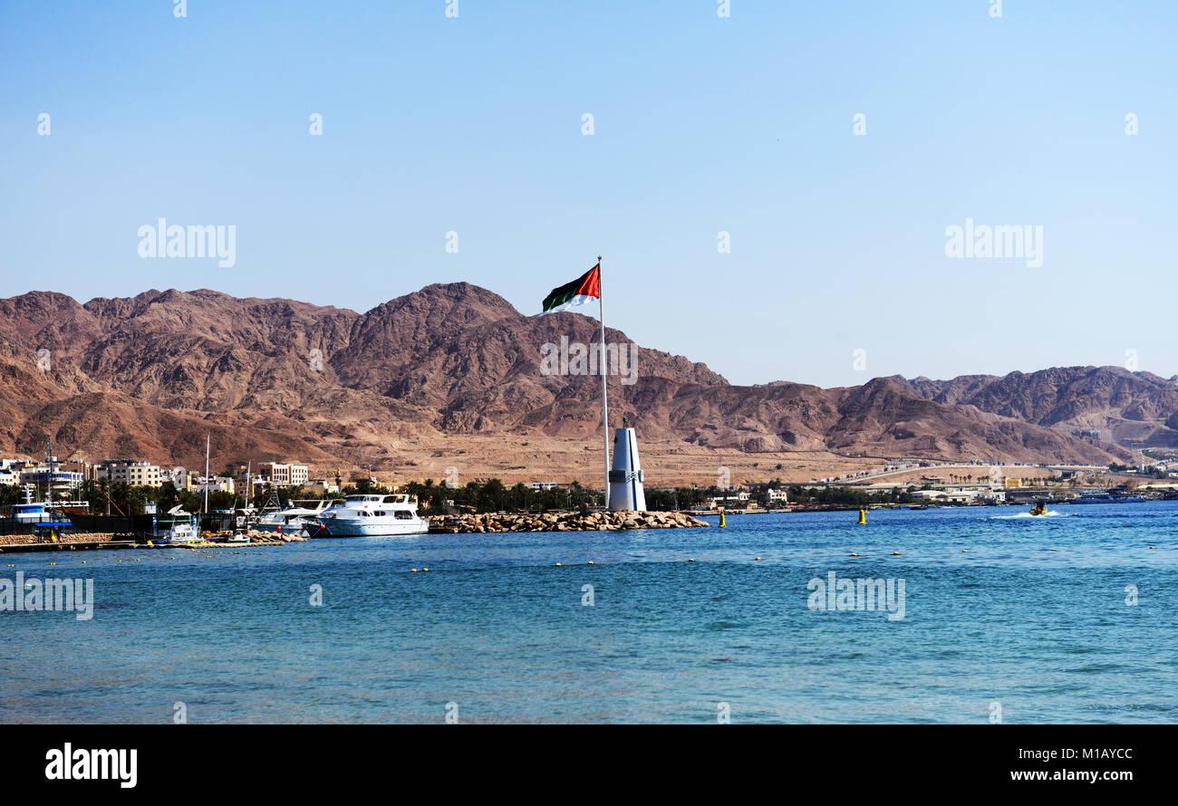 The Arab revolt flagpole is a major landmark in Aqaba, Jordan. - Stock Image