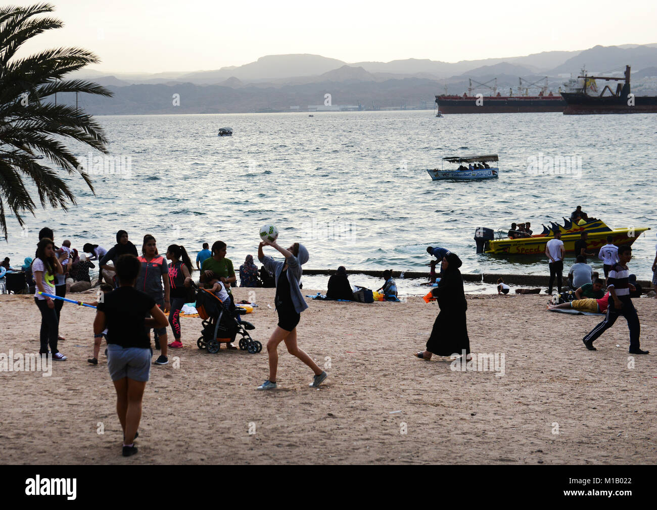 Jordanian girls playing beach volleyball  on Al-Ghandour Beach in Aqaba, Jordan. - Stock Image