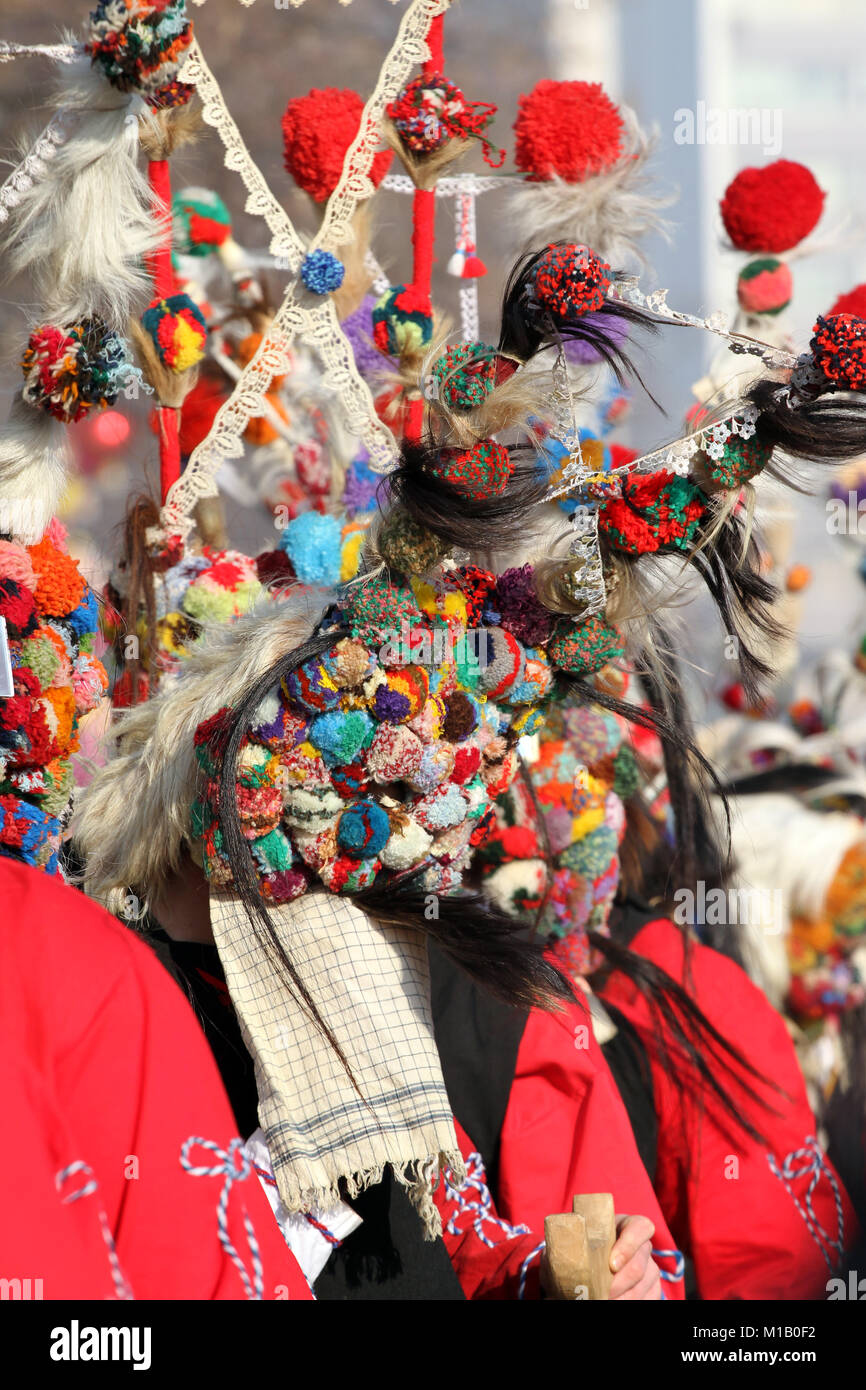 Kukeri, mummers perform rituals intended to scare away evil spirits during the international festival of masquerade - Stock Image